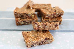 Pieces of slice piled together, filled with oats, trail mix, rice bubbles and chocolate chips