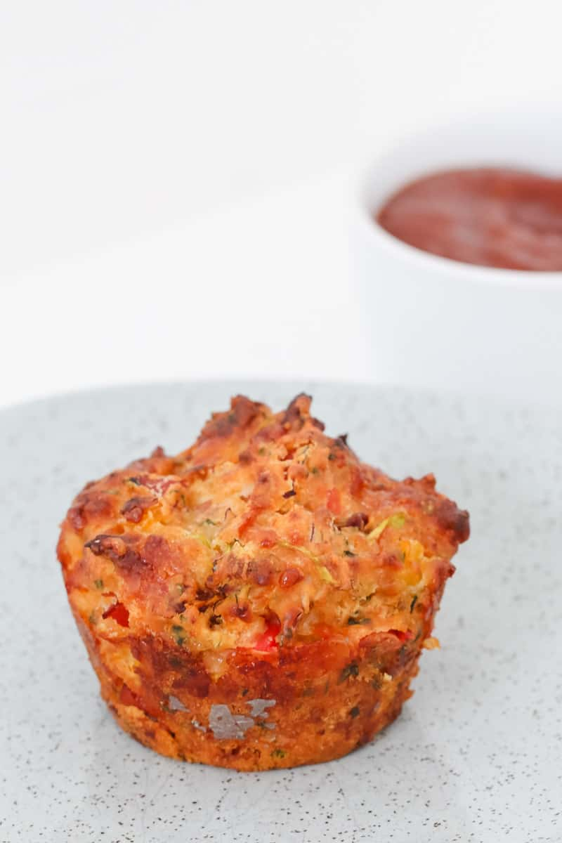 A vegetable muffin on a plate.