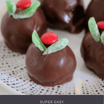 A plate of Christmas Mint Slice cheesecake balls covered in chocolate and decorated.