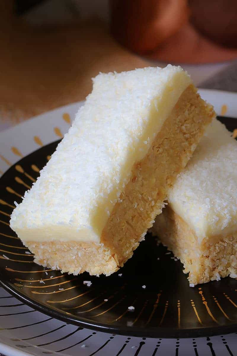 This new and improved Lemon & Coconut Slice recipe is absolutely perfect! A beautiful tangy base topped with a creamy lemon frosting... it seriously doesn't get any better than this!