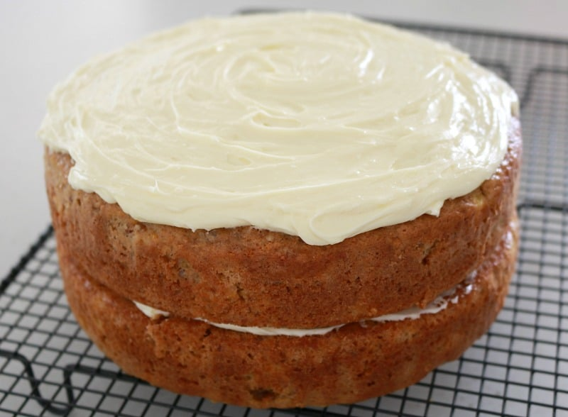 Carrot cake with pineapple topped with cream cheese frosting