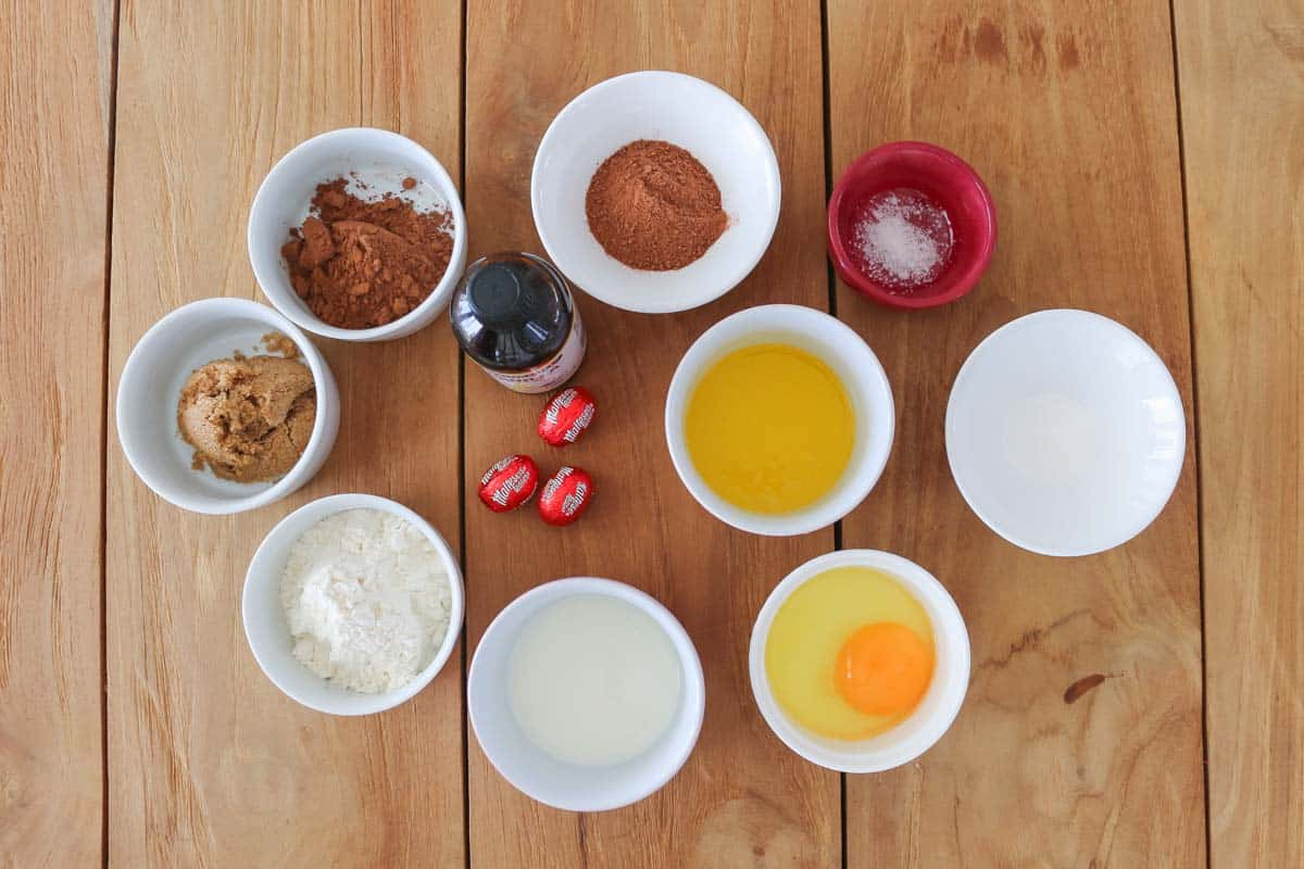 The ingredients needed for a chocolate mug cake recipe.