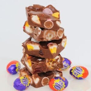 This Easy Easter Rocky Road is filled with marshmallow eggs, mini Cadbury creme eggs, crispy M&M speckled eggs and raspberry lollies!