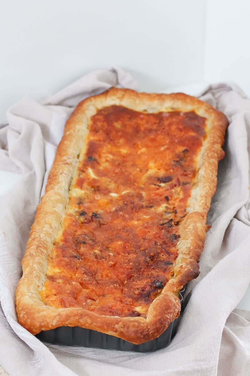 A rectangular puff pastry quiche.