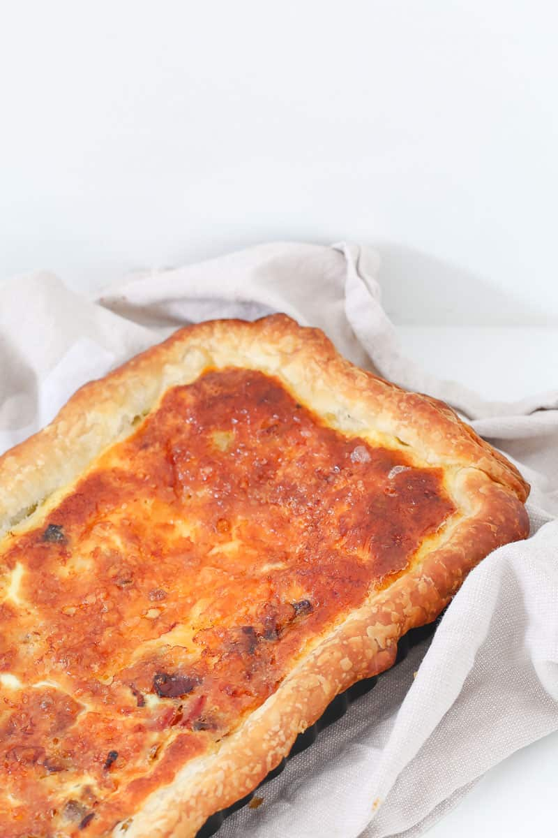 A puff pastry pie with egg and bacon.