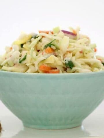 Apple coleslaw in a pale blue bowl