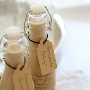 Two filled bottles with handwritten labels attached.
