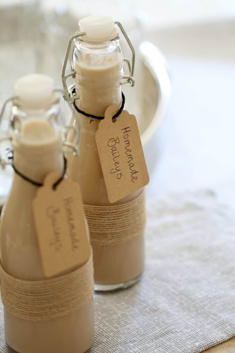 Homemade Baileys in small glass bottles with handwritten labels