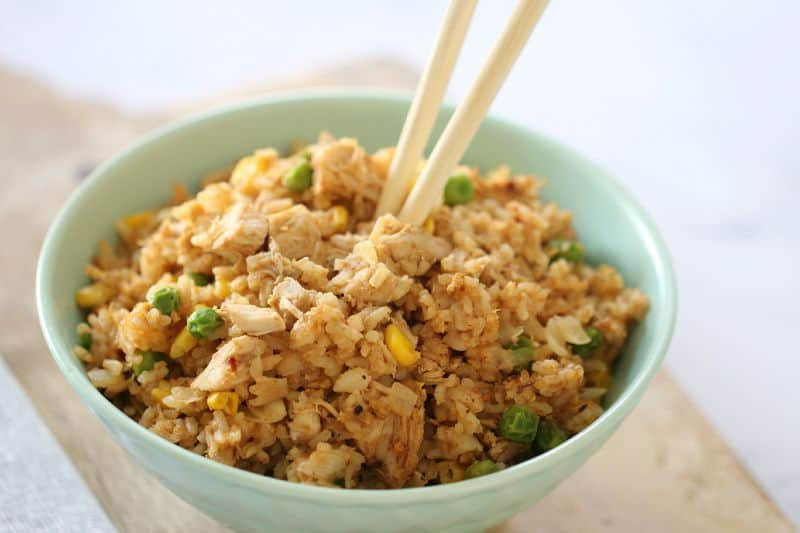 Fried rice and chopsticks in a bowl of chicken fried rice