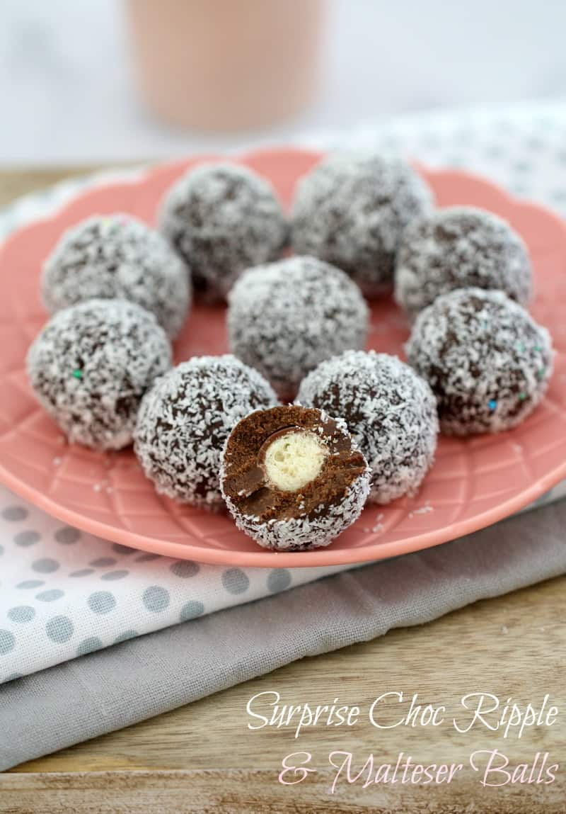 A pink plate of coconut covered Malteser Balls