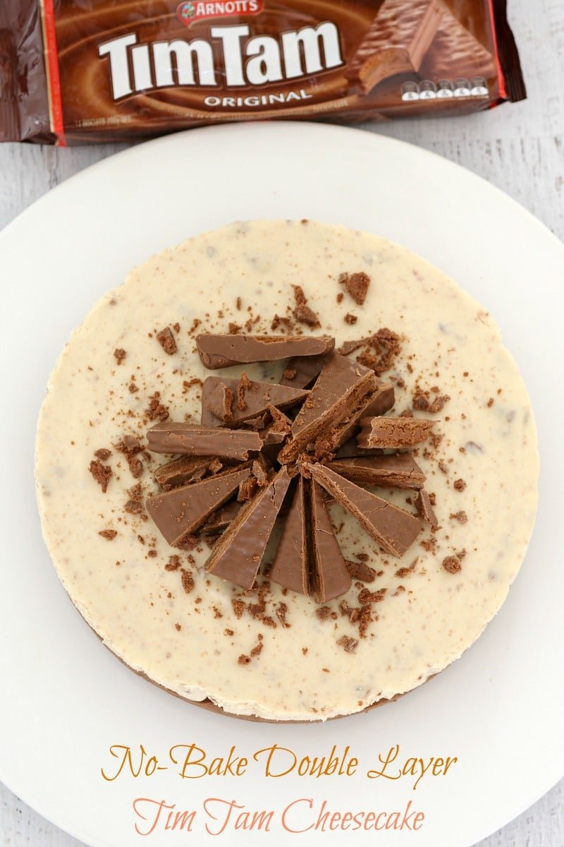 An overhead shot of a Tim Tam cheesecake showing wedges of Tim Tam biscuits and crumbled chocolate on top of a creamy layer