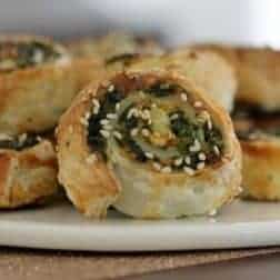 A close up of a plate of savoury pinwheel scrolls