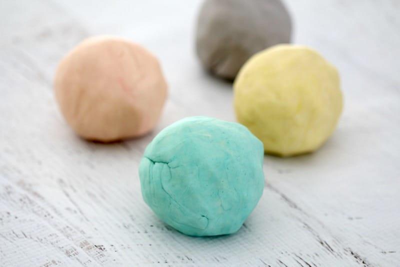 4 Round balls of playdough.