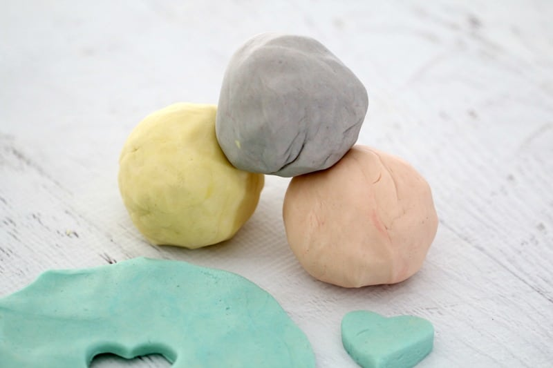 A stack of homemade play doh balls.
