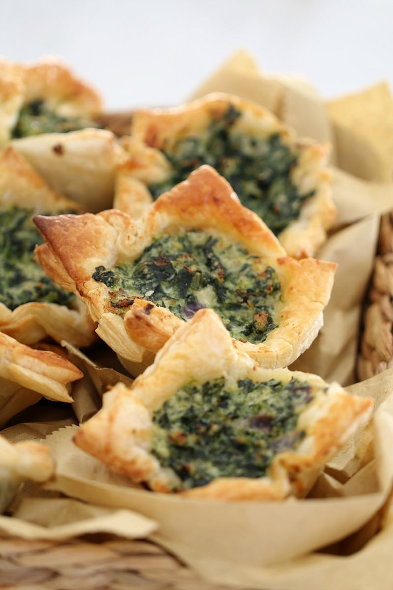 A close up of spinach and ricotta in golden pastry squares