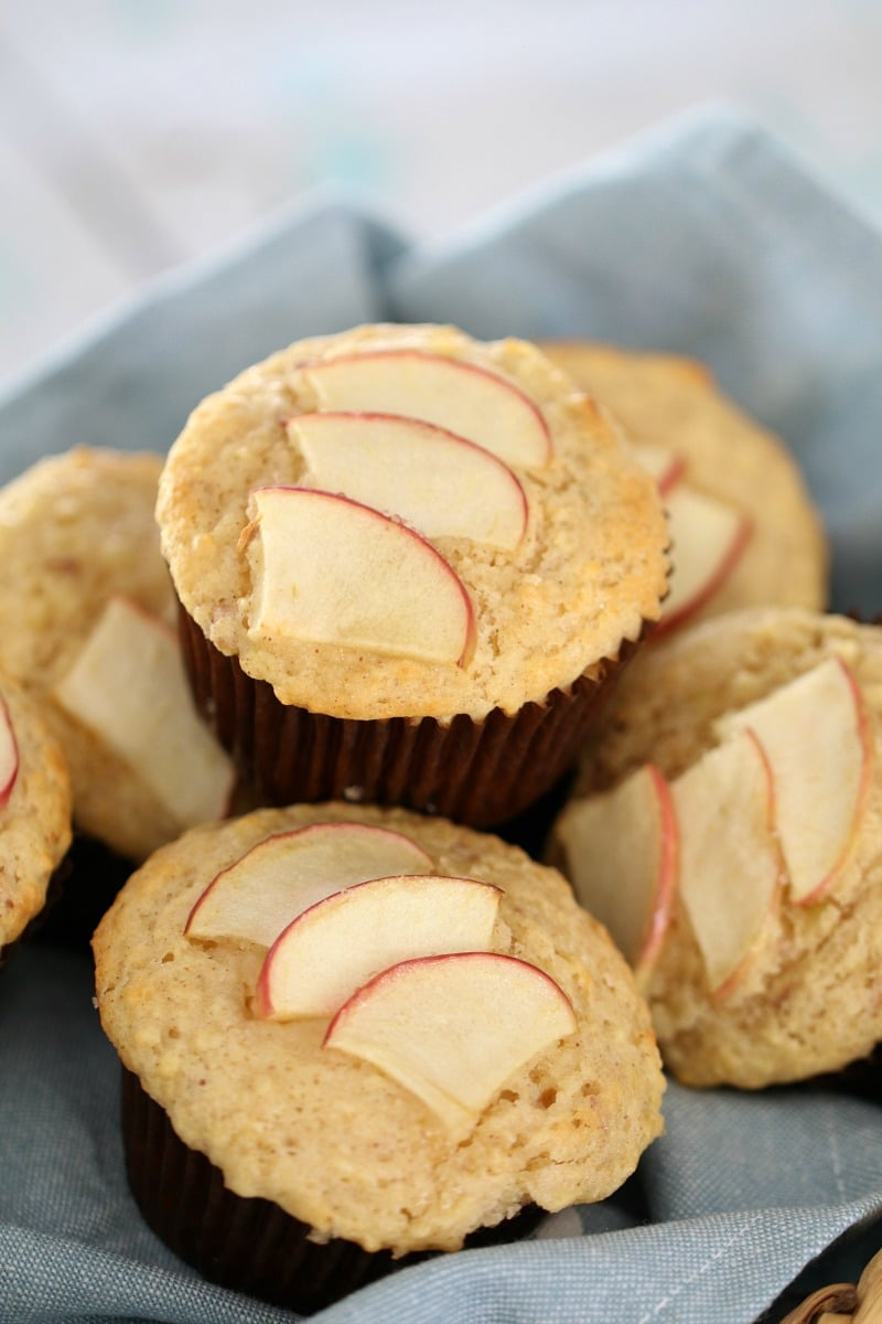 Apple slices on top of muffins in a cane basket