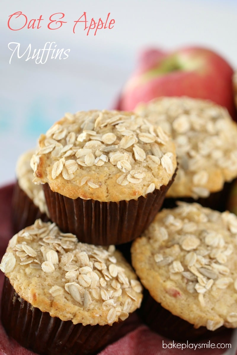A close up of muffins baked in brown muffin cases with oats sprinkled on top