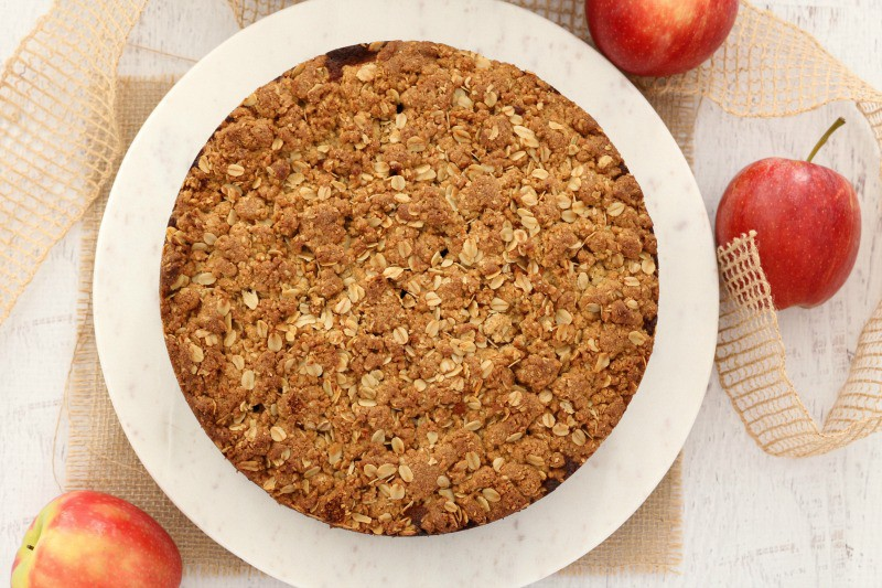 Looking down at a round cake topped with crunchy streusel.