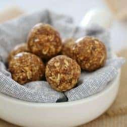 A small white bowl filled with a napkin and bliss balls