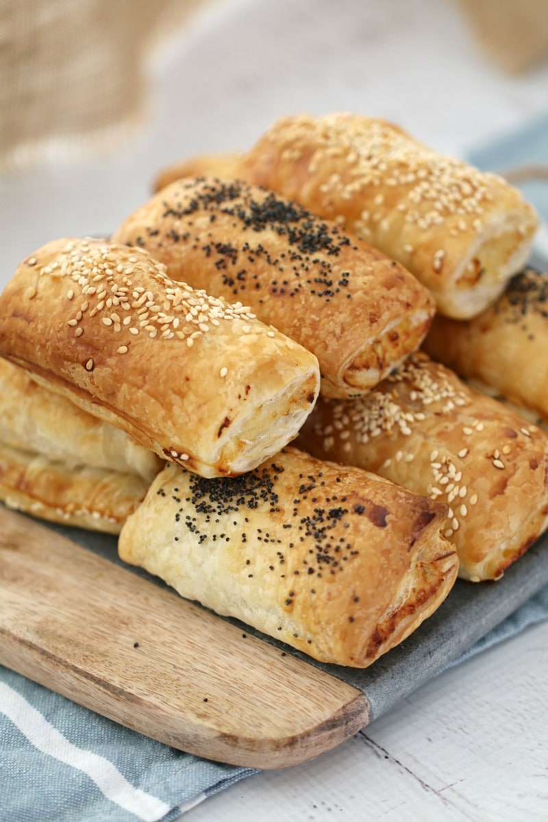 Sausage rolls baked with sesame seeds and poppy seeds sprinkled over the top