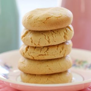 A stack of five Hokey Pokey biscuits on a floral plate