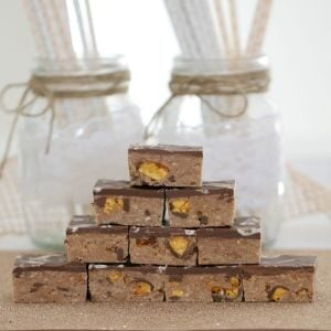 Pieces of slice stacked in a pile showing chunks of chocolate honeycomb inside