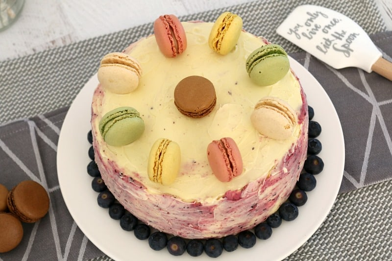 lemon layer cake with blueberry frosting