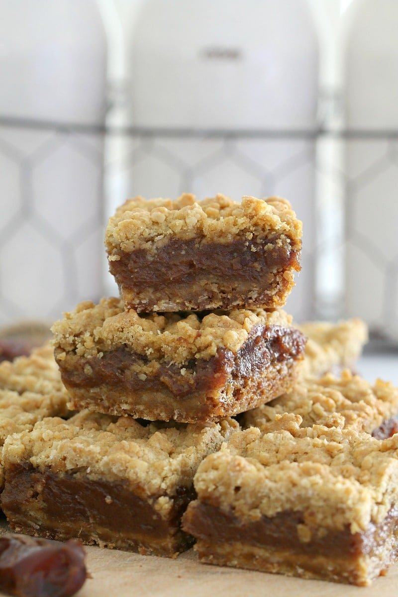 Stacks of baked oat and date crumble bars.