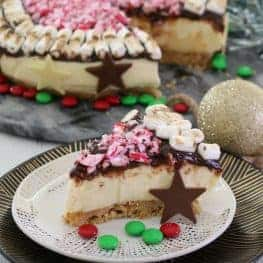 A slice of smore's Christmas cheesecake on a plate