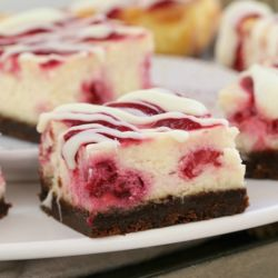 The BEST White Chocolate & Raspberry Cheesecake Slice