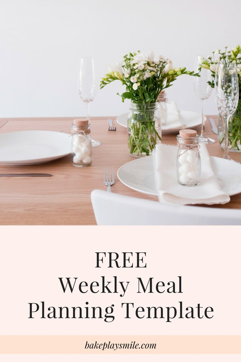 A table setting with white plates and cutlery and small vase of flowers with text saying Free Weekly Meal Planning Template