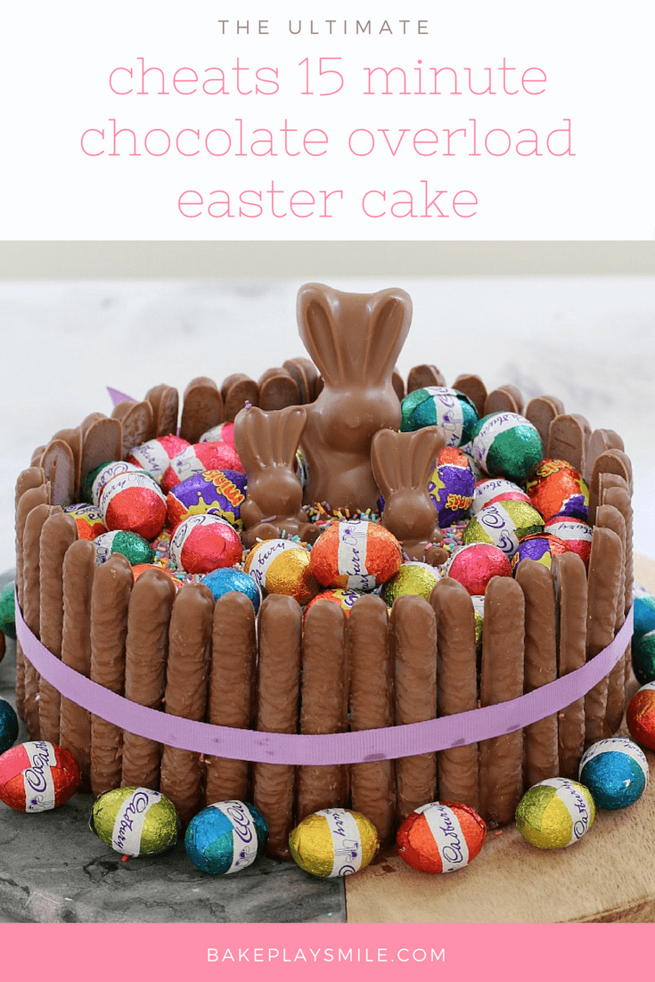 A chocolate easter cake hack with chocolate finger biscuits, easter eggs and Malteser bunnies.