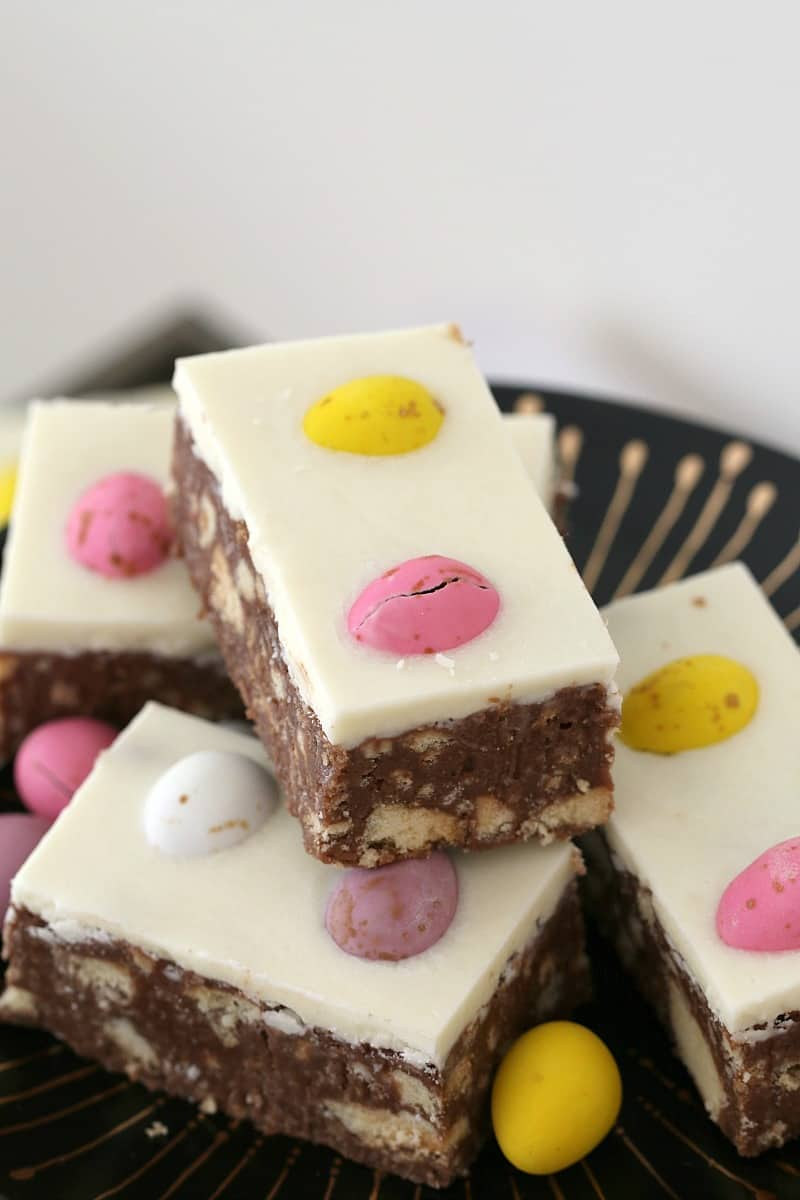 Pieces of a chocolate Easter slice on a plate.