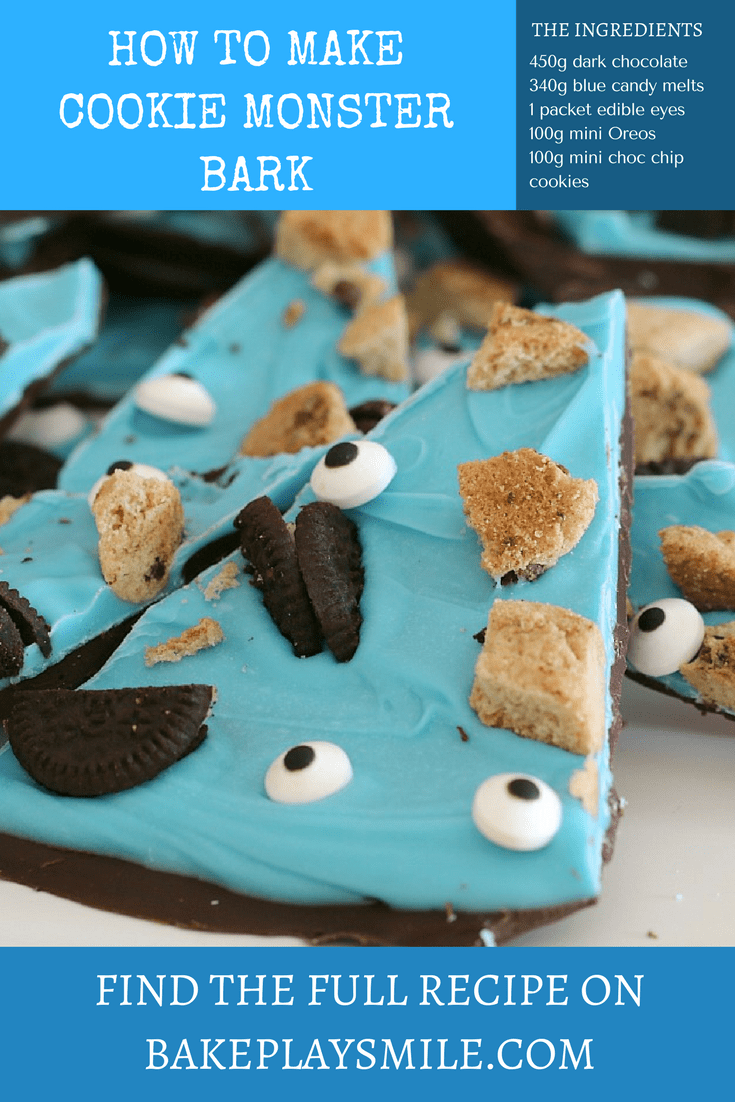 A close up of a blue candy layer decorated with broken Oreo and choc chip biscuits and edible eyes on chocolate bark wedges