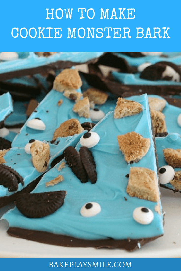 A pile of chocolate bark wedges topped with a layer of blue candy and decorated with broken Oreo biscuits, choc chip biscuits and edible eyes