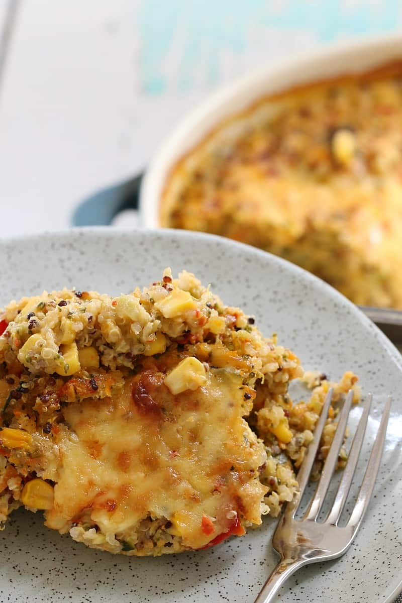 A plate and fork with a serve of a cheesy vegetable quinoa bake