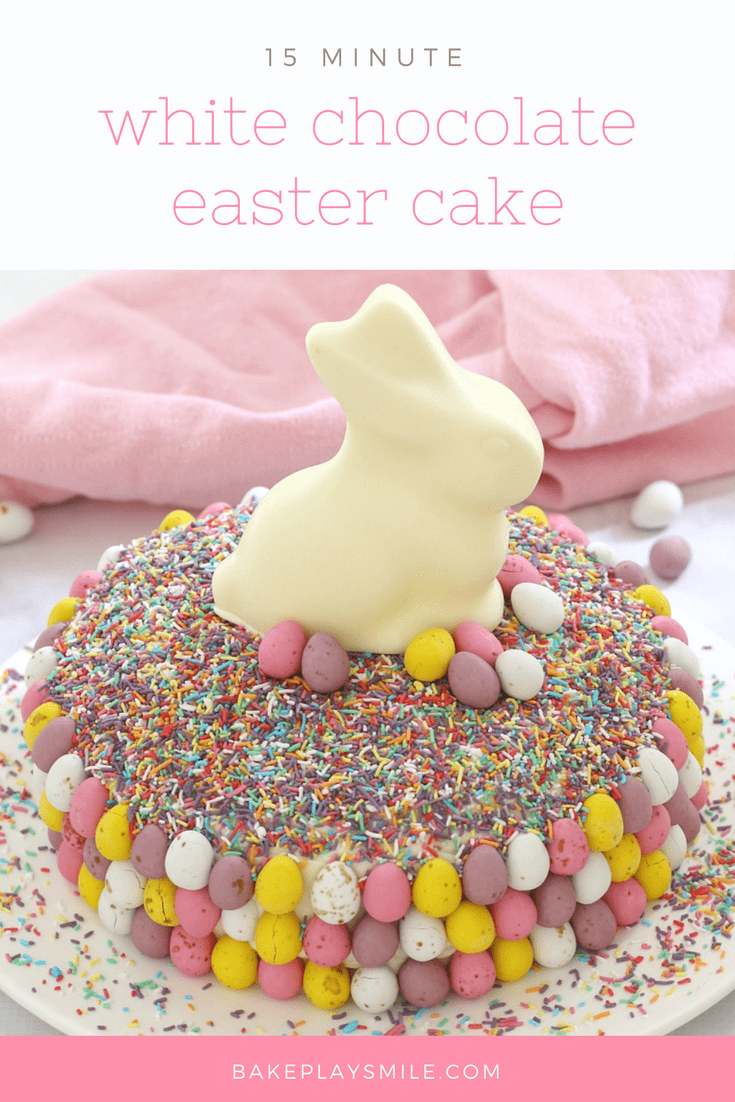 An easter cake with sprinkles, colourful easter eggs and a white chocolate bunny.