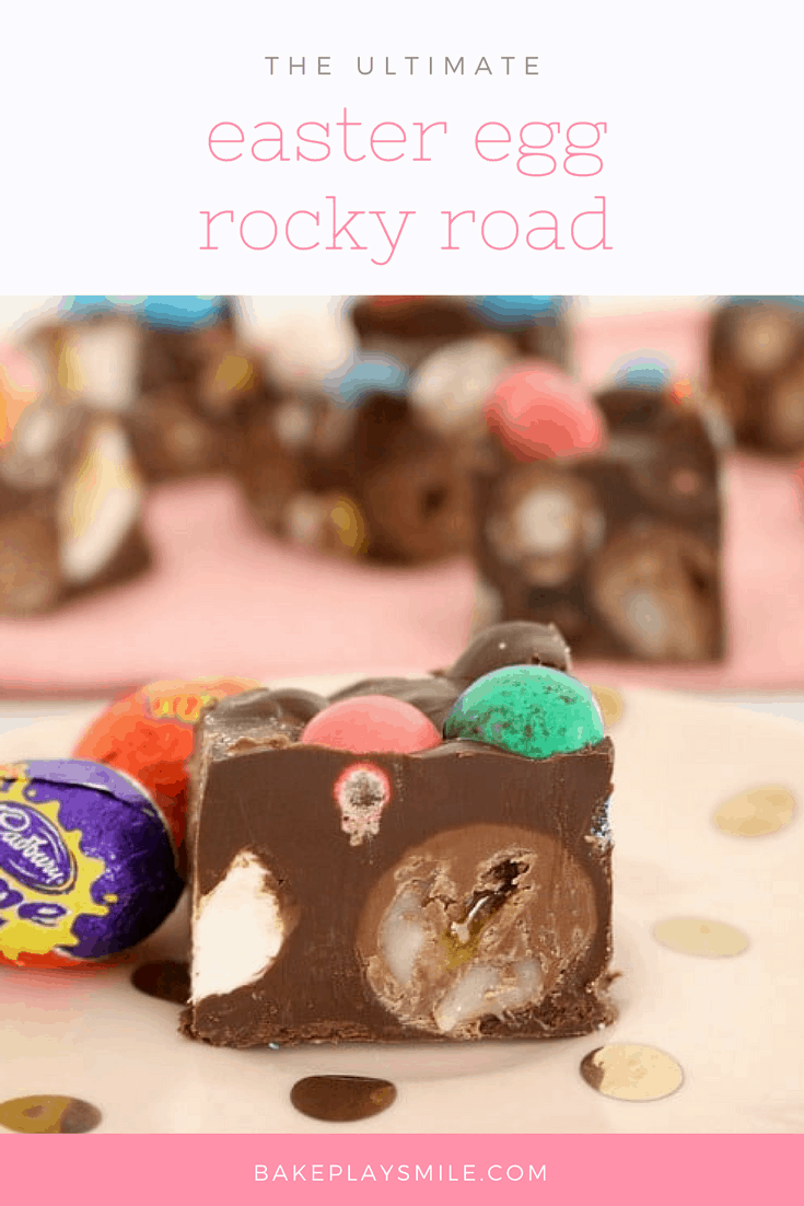 A close up of a piece of Rocky Road slice showing chopped Easter eggs inside and a couple of wrapped Easter eggs next to it