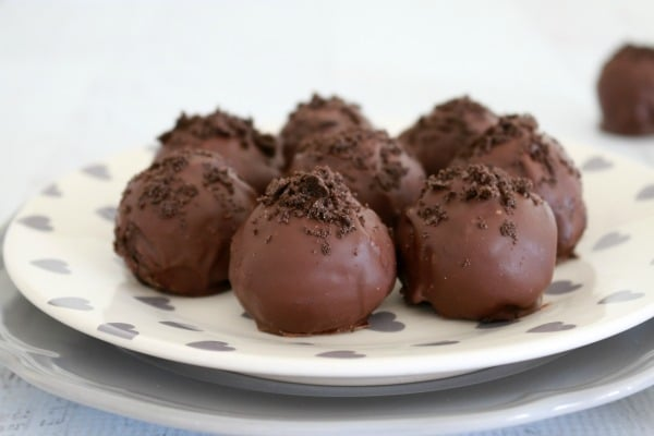 A plateful of truffles coated with chocolate and sprinkled with crumbled chocolate