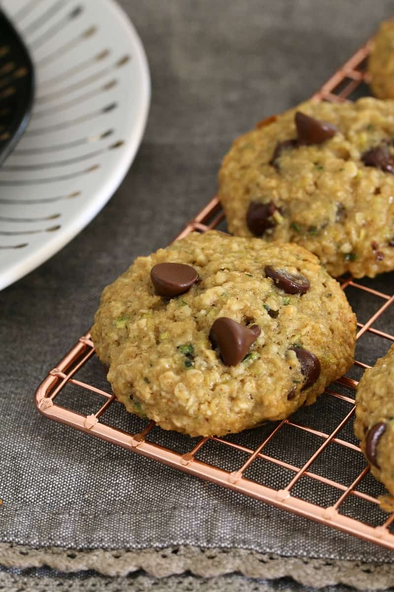 Zucchini, oat and chocolate chip cookies on a  copper wire tray