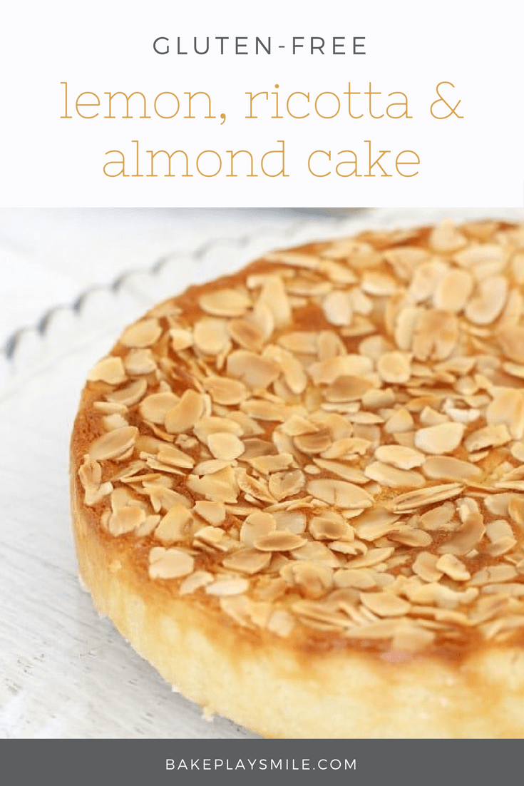 A close up of toasted flaked almonds on top of a lemon, ricotta and almond cake