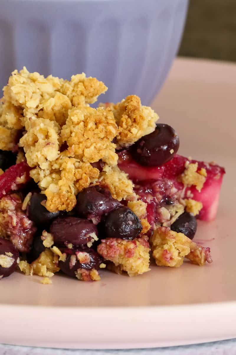 Blueberries with oat crumble on a plate.