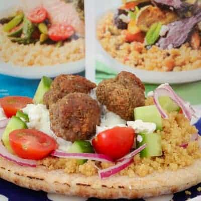 These super yummy oven baked Greek Lamb Meatball Pitas are the perfect family dinner! Top with couscous, cucumber, tomatoes, feta, red onion and tzatziki for a meal everyone will love.