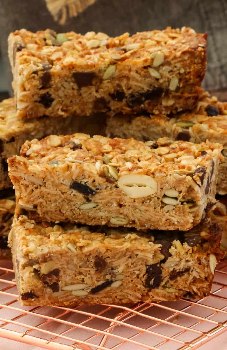 A close up of homemade muesli bars showing contents of oats, nuts, seeds and dried fruit