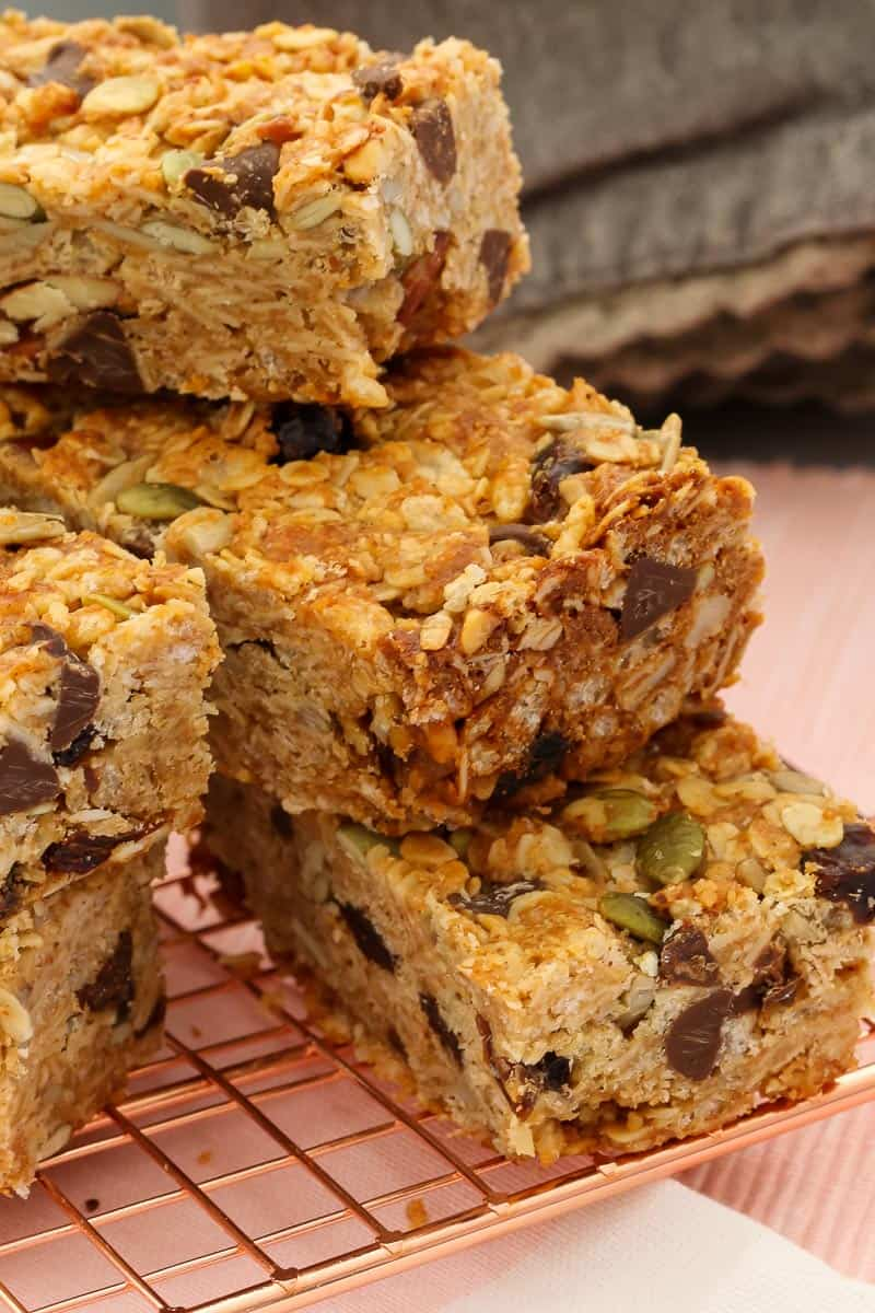 A close up of Muesli Bar slices showing a filling of rolled oats, nuts, seeds, dried fruit and more