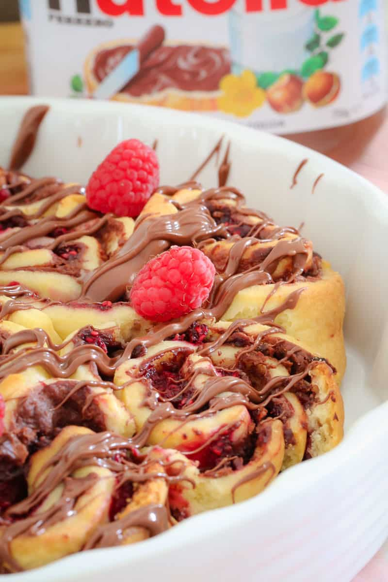These Raspberry & Nutella Scrolls are a chocoholics dream! They take less than 10 minutes to prepare and require no proving time at all! These freezer-friendly scrolls are the perfect lunch-box treat!