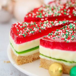 This really is the BEST Christmas Jelly Cake ever... with 5 pretty layers that make it the perfect no-bake Christmas dessert! Just like a traditional jelly slice... but with a Christmas make