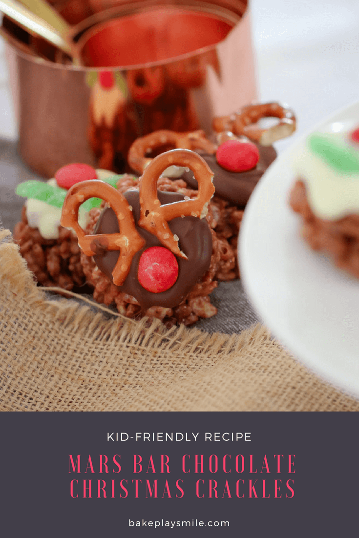 Chocolate Christmas Crackles decorated as reindeer with pretzels for antlers and a red M&M for a nose
