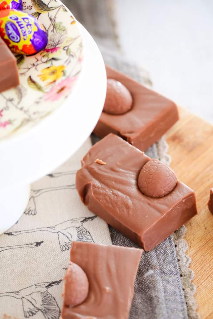 A super easy 5 minute microwave Cadbury Creme Egg Fudge made from just 3 ingredients... condensed milk, chocolate and Cadbury Creme easter eggs!
