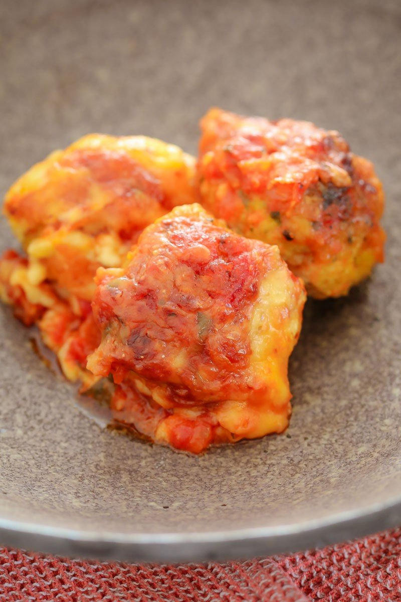 These Oven Baked Chicken Parma Meatballs with an Italian tomato sauce and melted cheese are a family favourite! Kid-friendly, easy and delicious!!